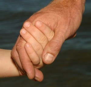 man-holding-childs-hand